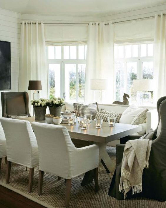 Vintage chic-beautiful upholstered chairs around rustic table