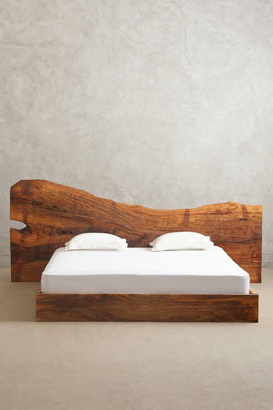 Amazing solid wood bed head from a slice of tree trunk for Wooden bed head designs