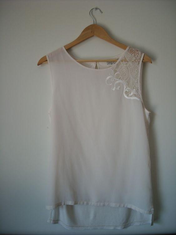 http://blogdaurraca.blogspot.pt/2013/05/novidades-do-dia-tops.html preço: 13,90€ encomendas: urraca.loja@gmail.com