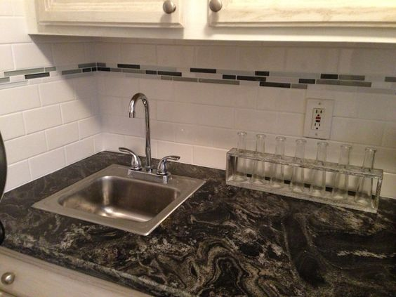 White Subway Tile With Glass Accent Backsplash