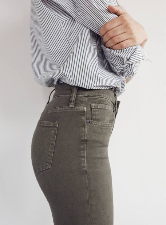 high waisted jeans and a tucked in button up