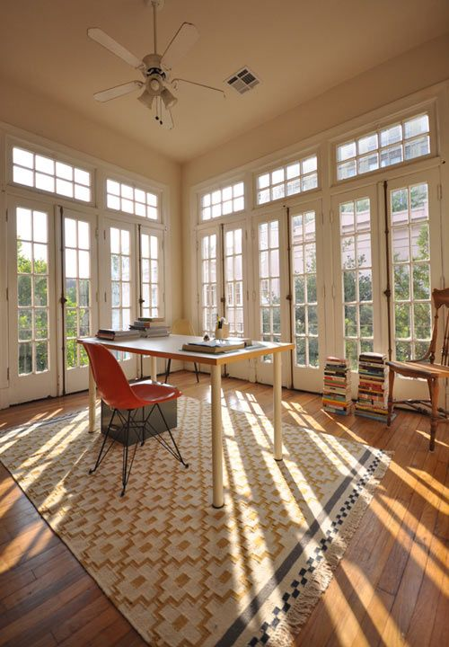 New Orleans courtyard apt.,  beautiful, original French doors with transoms.  What a perfect office!  features IKEA rug.