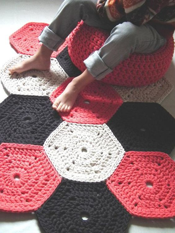 This colorful crocheted area rug is made from recycled t ...