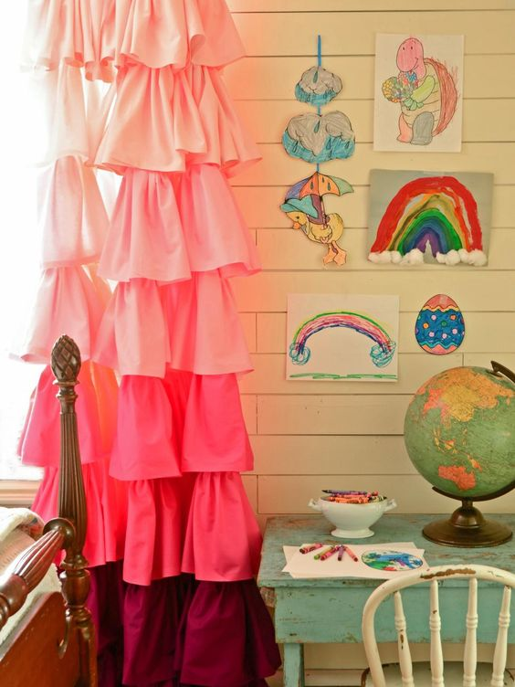 These ruffled ombre curtains—stitched together in an afternoon from rescued bed sheets—add a fun, feminine charm to a little girl's room. Try switching out the pink fabric for white to add texture to any space.