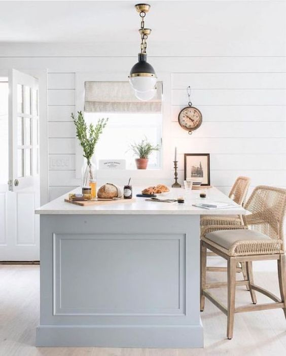 White kitchen with farmhouse style, shiplap walls, dutch door, and airy rattan bar stools. #modernfarmhouse #kitchen #whitekitchen #shiplap #moderncountry