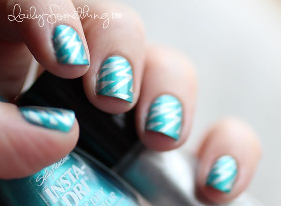 Super hero nails. Silver lightening bolts stamped over pale turquoise.