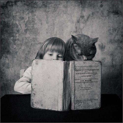 Girl, cat, book