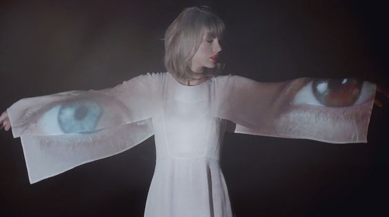 "Taylor Swift's ""Style"" Video Is Full of Romantic White Dresses: Taylor Swift can transition from a crop top to a full, feminine dress in an instant — and she never takes off her red lipstick."