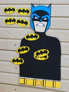 This custom 'Pin the Emblem on Batman' party game was a big hit at the party.   It was created by tracing the birthday boy onto a large poster board and then decorating.  The Batman emblems were made using a Cricut machine and Batman: The Bold and the Brave Cricut cartridge.