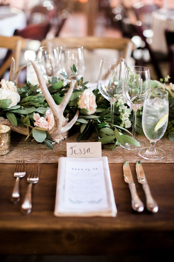 Rustic table decor with antlers and bare wood: http://www.stylemepretty.com/vault/gallery/38379 | Photography: Brittrene Photo - http://brittrenephoto.com/