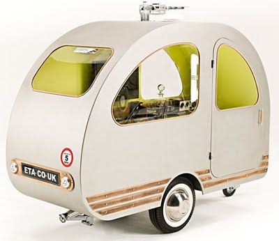 ETA,  miniature caravan: can be pulled by a Bicycle.  Contains bed, TV, shelves, more,