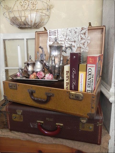 Vintage suitcase vignette: I love old vintage suitcases, silverware and books, so I especially love this great combination of all three :)