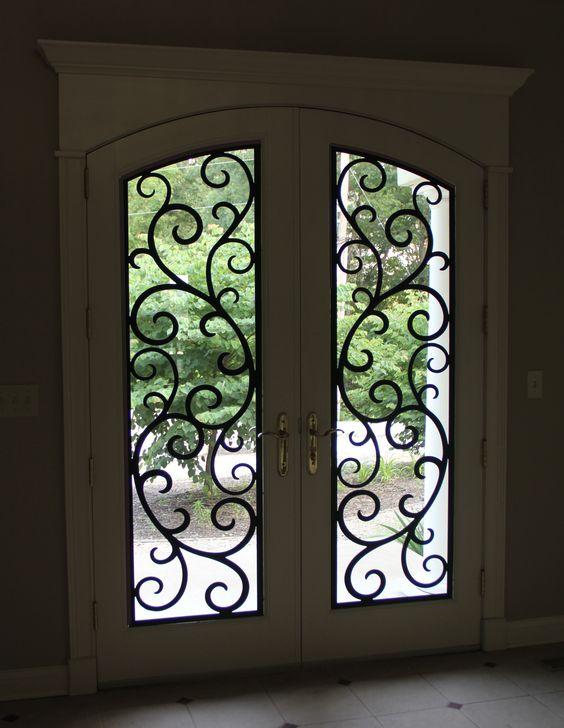 Beautiful iron doors and doors on pinterest for Wrought iron front doors