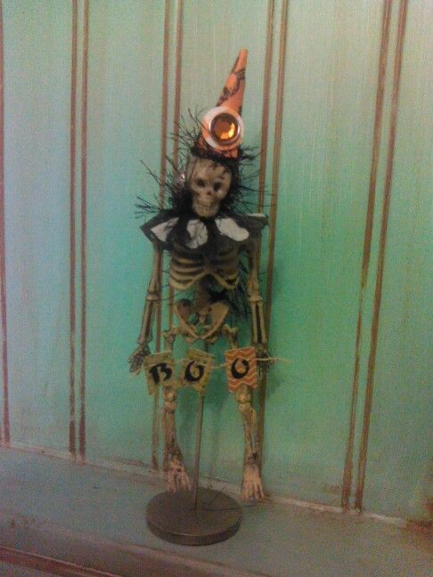 Rosie's Halloween ornament. Made w/dollar store skeleton garland & a bit of scrape paper.