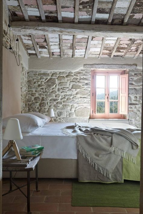 Rustic stone farmhouse bedroom in Umbria. European Farmhouse and French Country Decorating Style Photos. #rusticdecor #bedroom #stone #europeanfarmhouse #umbria