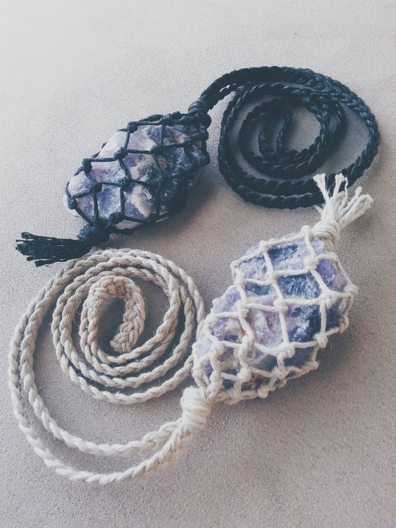Simple and beautiful braided macramé necklaces featuring vibrant XL rough Amethyst. Each crystal is wrapped using 100% hemp cord in black or