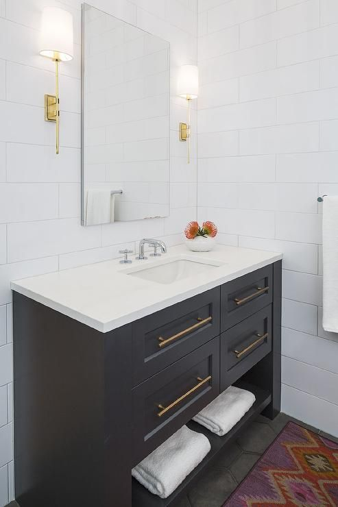 A Black 4 Drawer Washstand Finished With A Towel Shelf And Brass