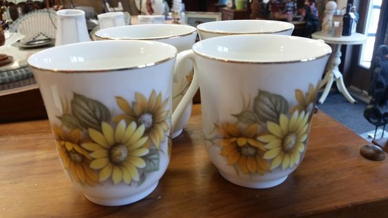 Four beautiful Queen's Anne's cups, $15 for all four. Lovely design, these would make a cup of tea taste even better!!