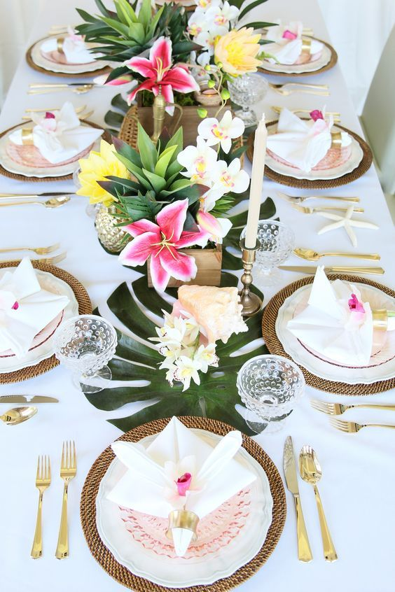 Palm leaves, tropical flowers, golden pineapples, wicker, seashells wedding centerpiece / http://www.himisspuff.com/green-tropical-leaves-wedding-ideas/5/