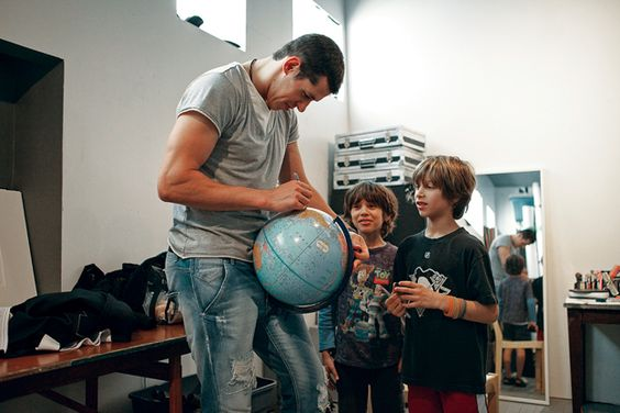 Evgeni Malkin signs an autograph for photographer Frank Walsh's sons.