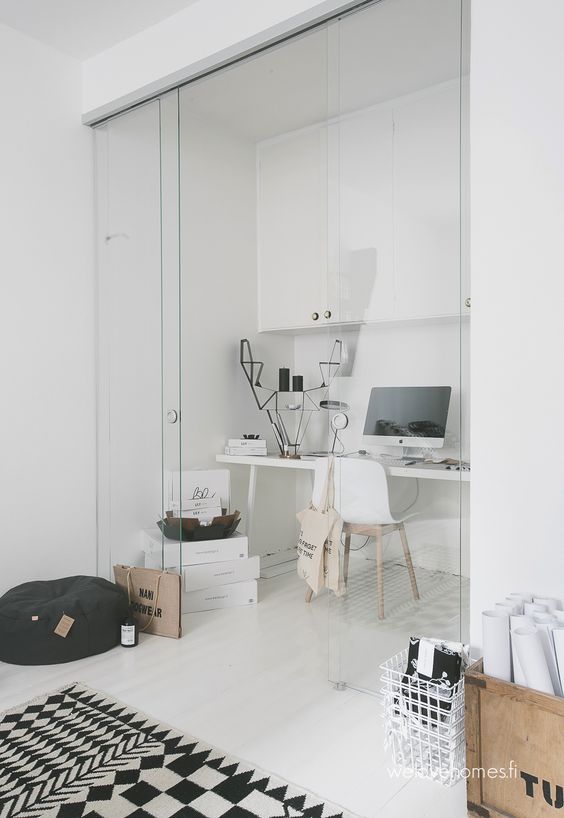 Home office with glass wall via We Love Homes