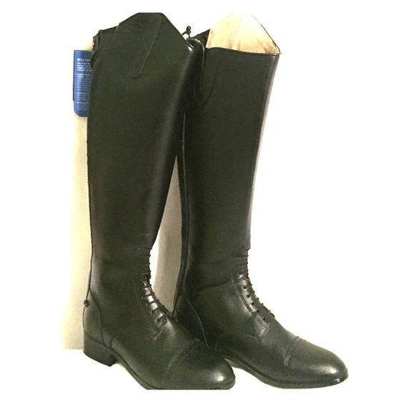 Dublin Monarch Riding Boots These Dublin riding boots have never been worn! They are in new condition and would be a great Christmas gift. They are black, laced up, paddock boots. They zip up in the back. IMPORTANT: size is 8 with narrow calf. Extra buttons and box are included. Please let me know if you have any further questions! Dublin Shoes Lace Up Boots