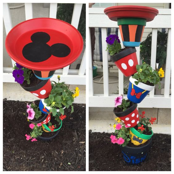 Disney planter/birdbath! Used patio paint and secured it with 1/2 in rebar! Amazing colors for spring!: