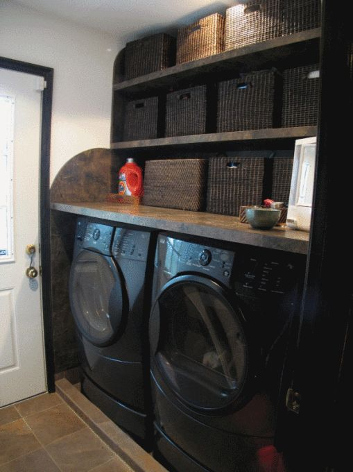 Laundry room - Table built above washer and Dryer, filled space with baskets and more baskets, love this