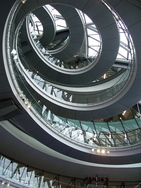 Upward Spiral ::  inside London's City Hall, in the main legislative chamber, where a dramatic staircase spirals its way up towards the ceiling.