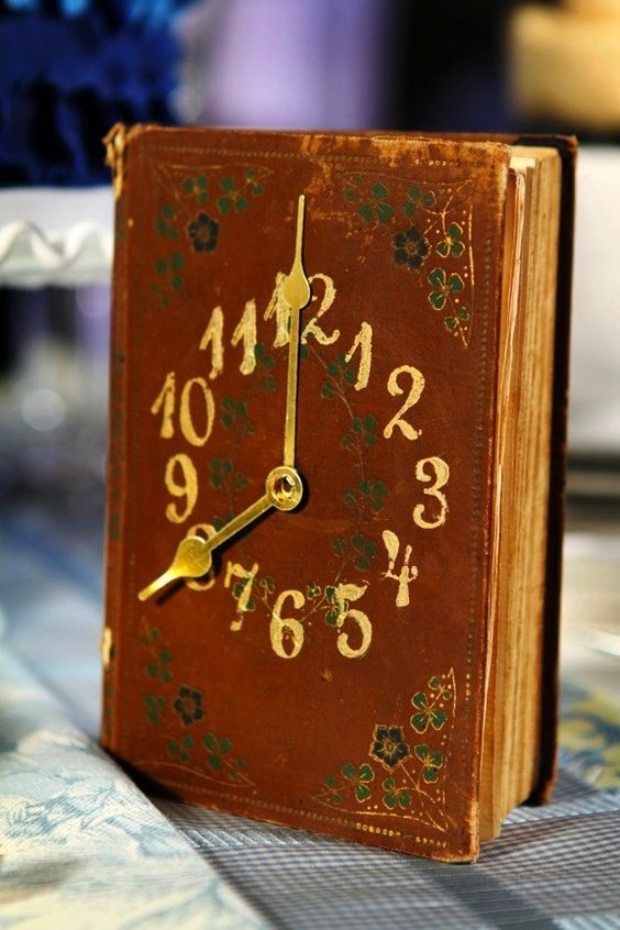 DIY Treasure Clock (this was one of many table markers/keepsakes for a wedding.. the time is the table number, and the couples pics are inside the book):