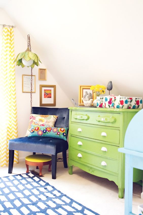 eclectic baby room...love the green dresser