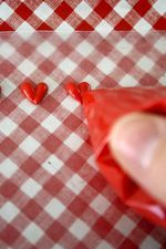 Tiny hearts made from candy melts.... add to cookies or cupcakes