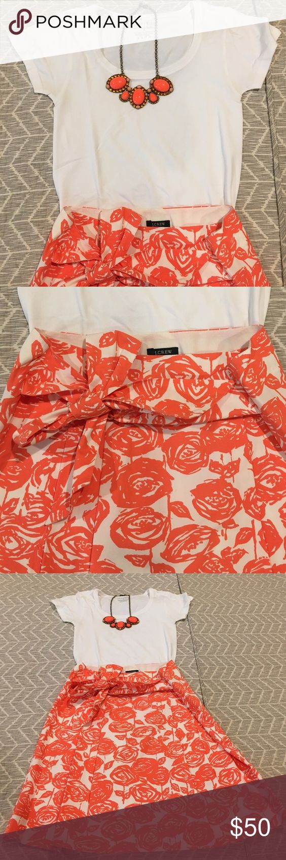 J Crew pleated skirt with white top! J Crew orange and white pleated skirt.  It has a zipper at the side and the pieces of fabric for the bow come from the sides of the skirt.  It is light weight and perfect for work, or a summer party!  It has been worn and has a VERY light spot on one of the pieces of fabric, which is not visible when worn.  It just came back from the dry cleaners.  The top is White House Black Market and a size s.  It is 95% Nylon and 5% Spandex. J. Crew Skirts Midi