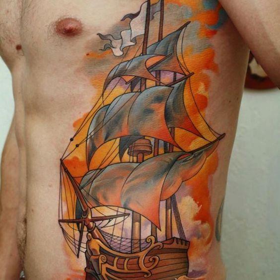 http://tattoomagz.com/stunning-black-ship-tattoos/orange-and-black-ship-tattoo/
