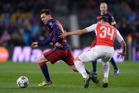 Barcelona's Argentinian forward Lionel Messi (L) vies with Arsenal's French midfielder Francis Coquelin during the UEFA Champions League Round of 16 second leg football match FC Barcelona vs Arsenal FC at the Camp Nou stadium in Barcelona on March 16, 2016.