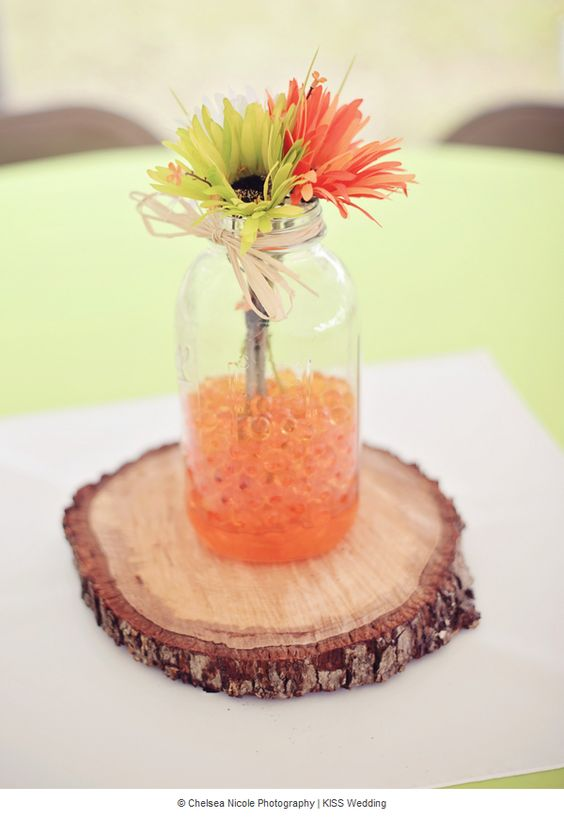 A diy wedding table centerpiece made with a mason jar for Orange centerpieces for tables