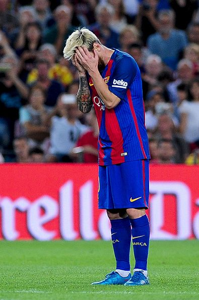 Lionel Messi of FCBarcelona reacts after a missed goal opportunity during the…