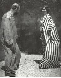 Gustav Klimt and Emilie Flöge in garden .