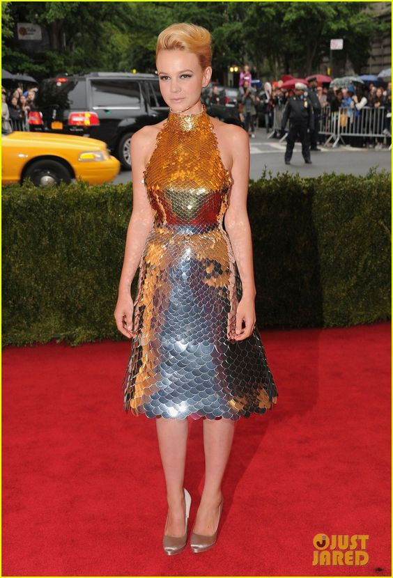 Met Ball 2012 - Carey Mulligan - all Prada – gold and silver degradé metal paillettes scaled halter neck dress, shoes, and bag.