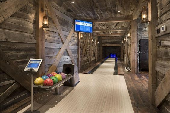 Dramatic Country/Rustic Game Room by Jerry Locati on HomePortfolio OMG! A bowling alley in a cabin!!!