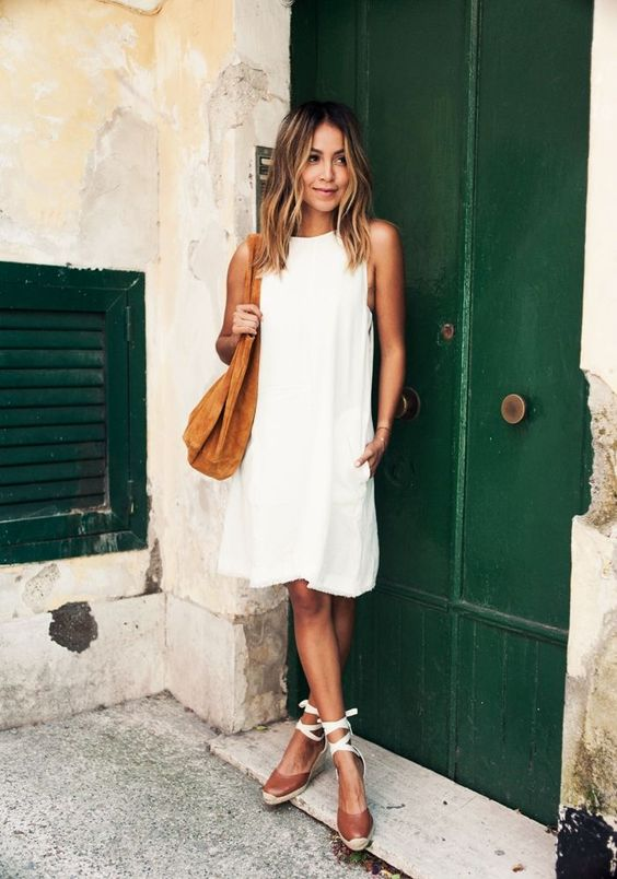 Simple dress with bag and tie up espadrilles, light thick barrel curl in hair: