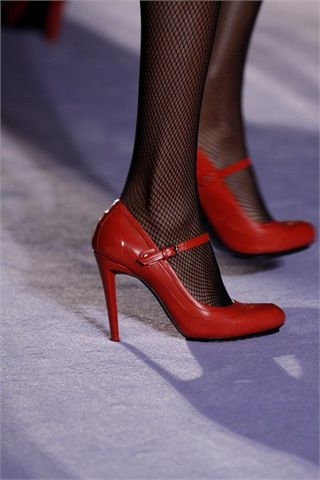 Red high heel mary janes and fishnet stockings. Paul Smith. | I