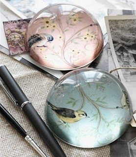 Bird in glass paperweights: