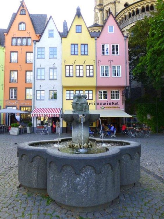 Colorful square in Cologne, Germany. The small cafes in this area are a great place to relax and enjoy a drink.