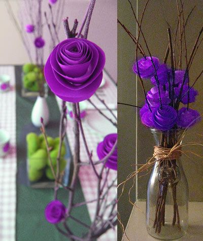 Paper Flower Centerpiece Ideas - they dont have to be paper. A few purple roses and twigs could look cool: