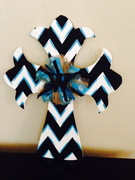 Painted wooden Cross Door Hanger with ribbon and chevron design.