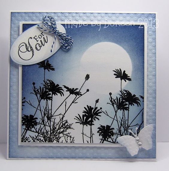 By Doreen. Stamp image in black VersaFine ink. Mask moon with a punched or die-cut circle. Sponge/dust sky with Distress ink faded jeans, milled lavender,  chipped sapphire, created dark  light areas. Remove mask. Drag sponge lightly across the moon to give the effect of clouds. Background panel dry embossed  sponged around edges.
