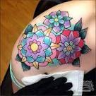 symmetric geometric flower tattoo