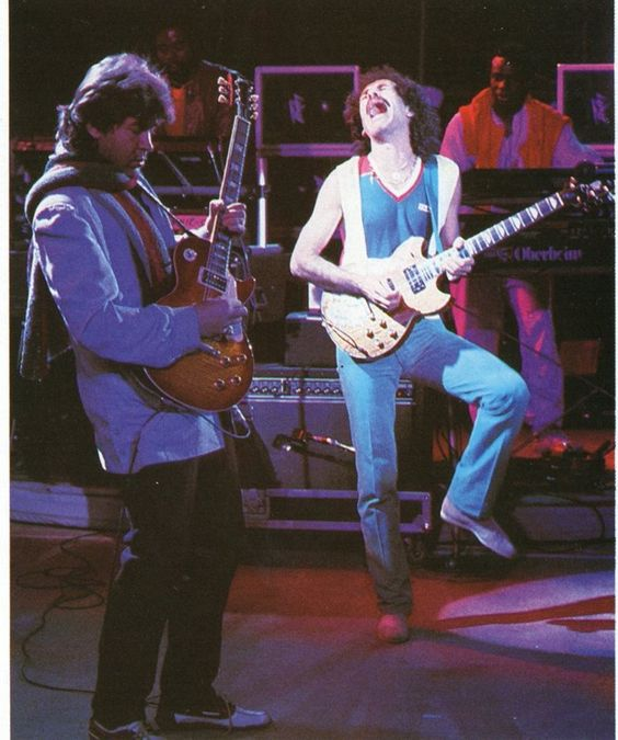 "Mick Taylor (John Mayall's Bluesbreakers, Rolling Stones), onstage with Carlos Santana (Santana) during: ""Bob Dylan's Real Live tour"", (c. 1984) - © 'Mick Taylor Fan Club'"