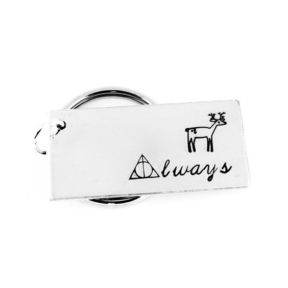 """Always Keychain - Deathly Hallows - Gift for Bookworm - Aluminum Key Chain. This """"Always"""" aluminum key chain is stamped by hand, one letter at a time and makes a great gift! The deathly hallows design replaces the """"A"""" in """"Always"""" and a deer design is stamped above the word. This item is made with an aluminum blank that measures 3/4"""" x 1 1/2"""" in size, with a jump ring attaching a 1"""" split key ring. Please note that due to the nature of hand stamping, every item varies slightly from the photo."""